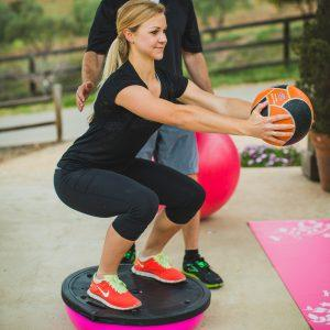 Squat on flat side BOSU-with Medicine Ball
